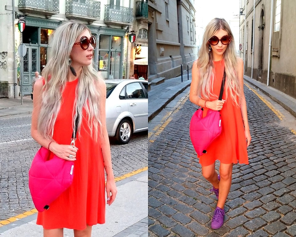 Joanna L from United Kingdom wears an orange BOOHOO dress with purple Adidas sneakers