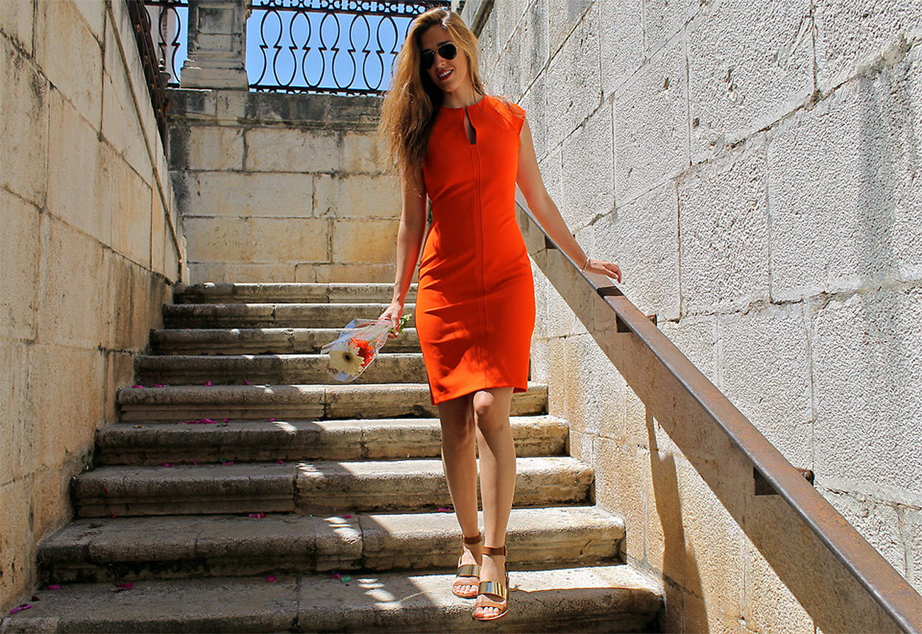936a65c3e Natalia Champs from Spain wears an orange Zara bodycon dress wth beige gold  Zara sandals