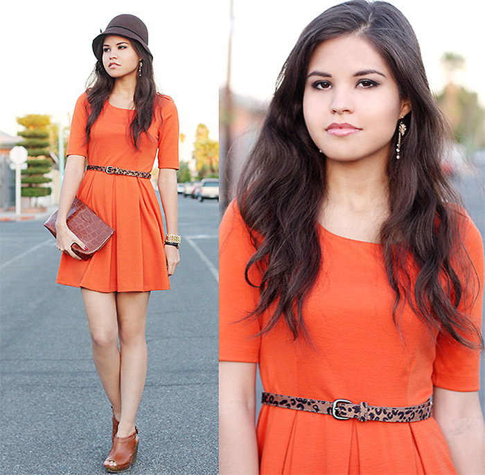 Personal style blogger Adriana Gastelum wears tan brown wedge sandals with an orange skater dress