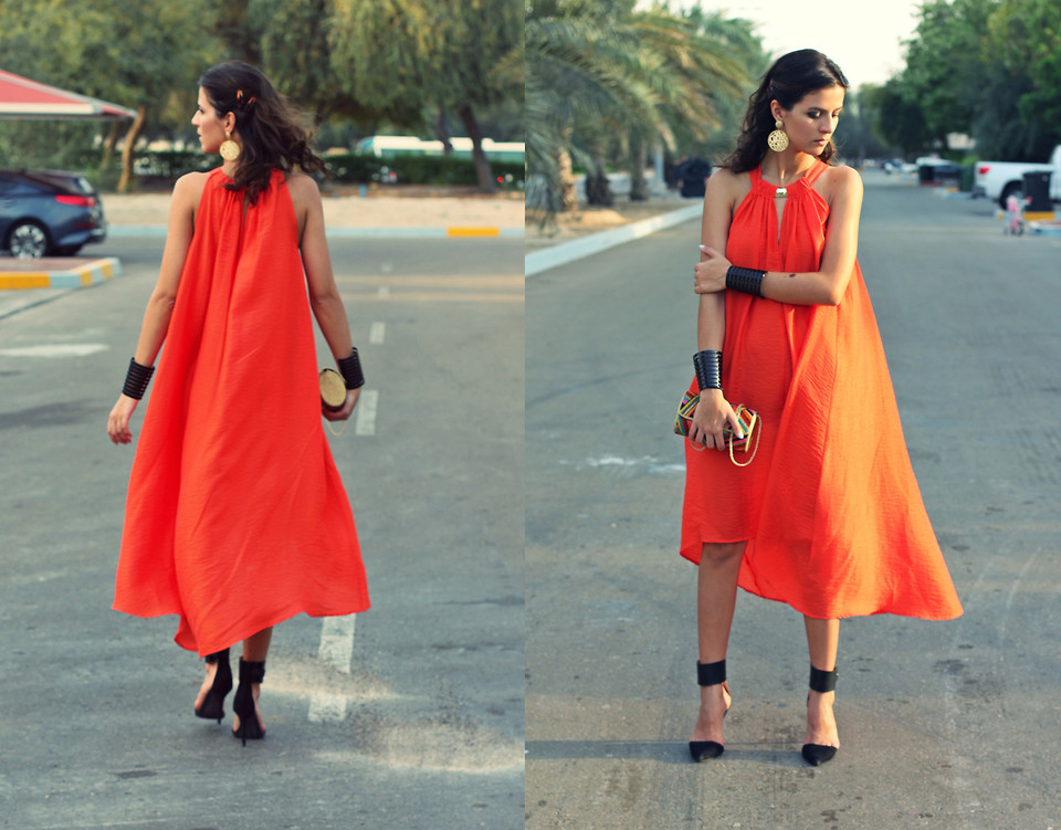 Sewing enthusiast Susanna Vesna from Abu-Dhabi, United Arab Emirates wears black Zara heels with an orange H&M dress