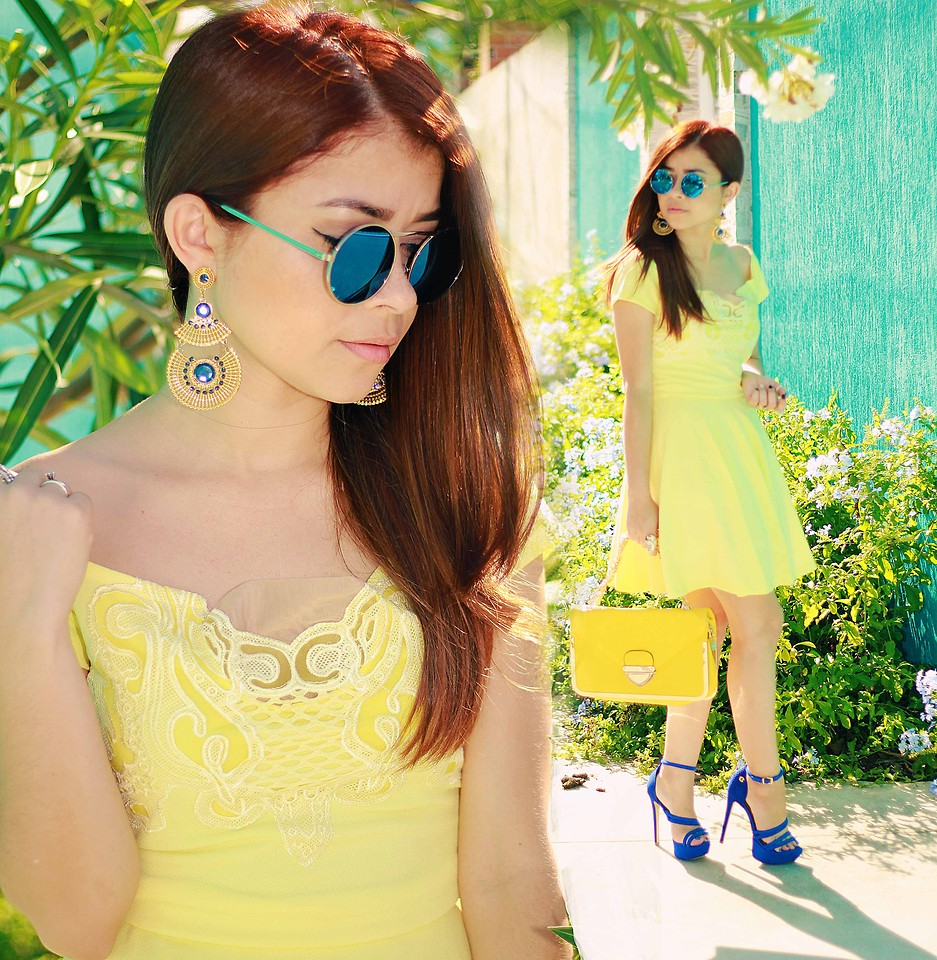Leticia Oliveira Blogger designer photographer and singer from Cabo Frio Brazil wears blue shoes with a yellow dress