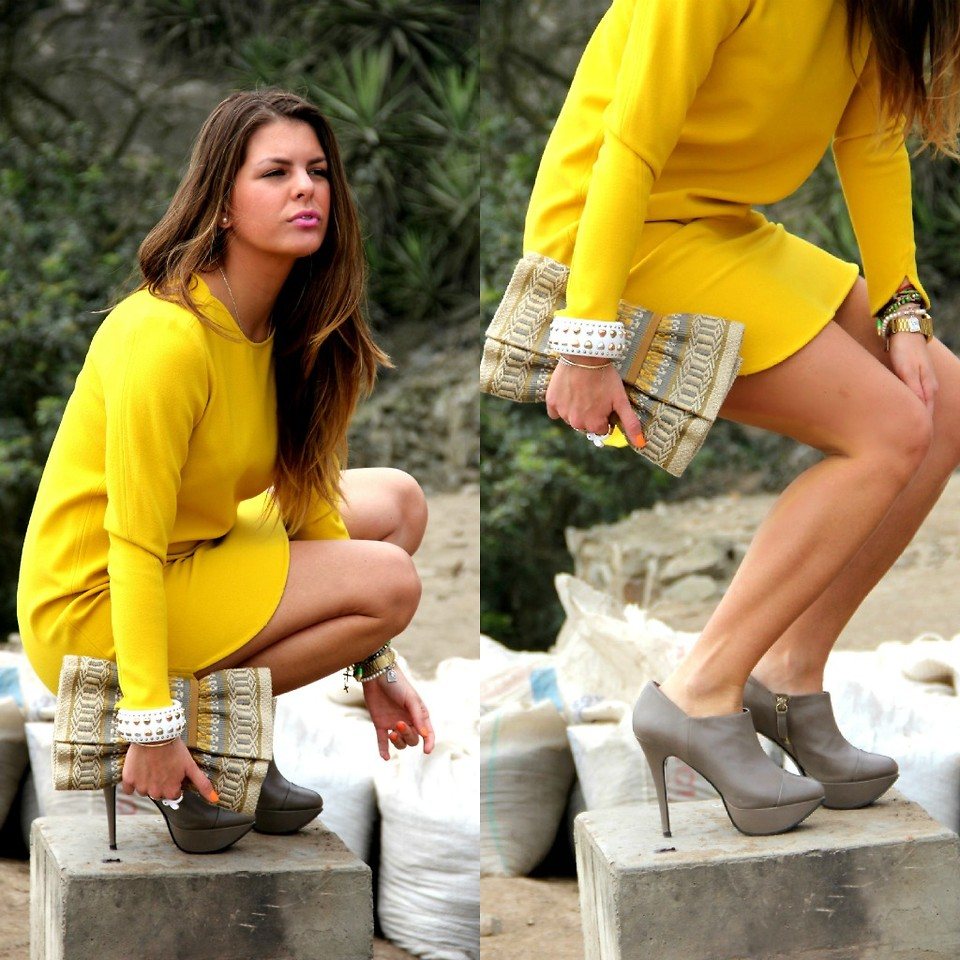 Peruvian Fashion Blogger Antonella Carvajal Santacroce wears gray booties with a yellow dress