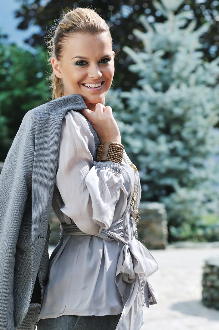 gray clothing young woman posing in fashionable clothing outdoor